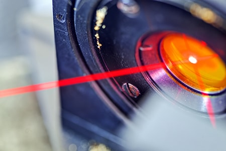 Red Laser on Optical Table in Physics Laboratory